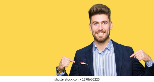 Young handsome bussines man looking confident with smile on face, pointing oneself with fingers proud and happy.