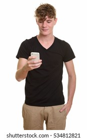 Young handsome Caucasian man holding mobile phone