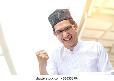 Young Handsome Confident Arab Muslims businessman expressing success, Success Concept