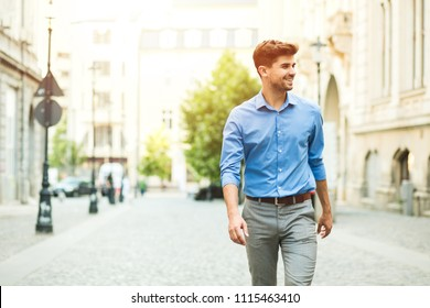 young handsome and confident guy in smart casual outfit, office day, standing outside on the street and looking to side