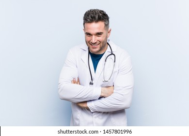 Young handsome doctor man laughing and having fun.