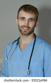 young handsome doctor smiles with stethoscope on his neck