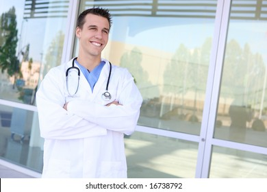 A young handsome doctor smiling outside hospital
