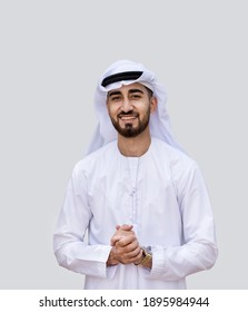 Young handsome Emirati business man in UAE traditional outfit showing a variety of hand gesture. Arabic ambitious mature businessman.