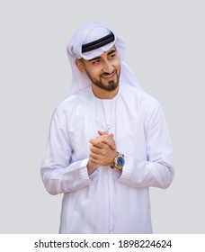 Young handsome Emirati business man smiling in UAE traditional outfit and showing a variety of hand gesture. Arabic ambitious mature businessman