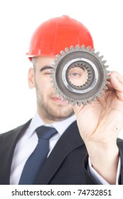 Young handsome engineer examine a gear