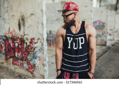 young handsome fashion bearded model man in urban context