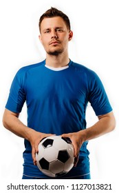 Young handsome football player holds in hands soccer ball posing on white isolated background. in full growth.