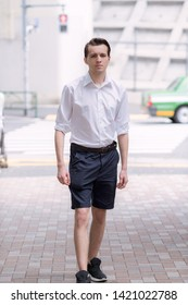 Young handsome French man walking in the Streets of Tokyo
