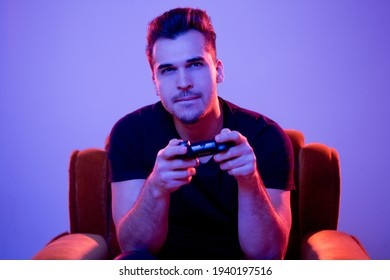 Young handsome gamer ready for online battle.