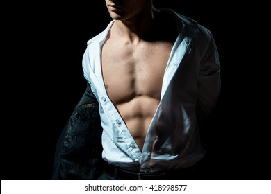 young handsome gentleman wearing fashion black suit in white open shirt with bare torso