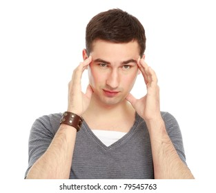 A young handsome guy having a headache, isolated on white