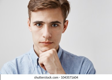 Young handsome guy looks to the camera with kind eyes. Sister wanted to tell him something privately. Girl wants him to know first that she is getting married. Parents do not know yet