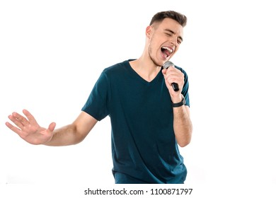 Young handsome guy singing karaoke expressively isolated on white background. Song. Melody. Studio portrait.