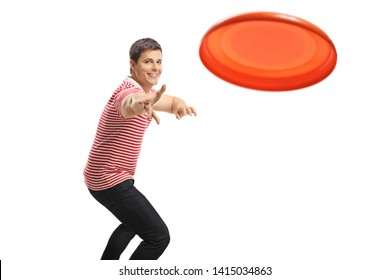 Young handsome guy throwing a disc isolated on white background