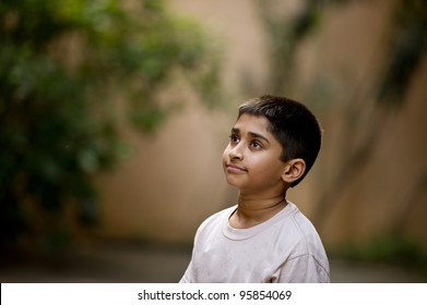 an young handsome Indian kid day dreaming