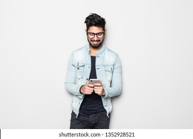 Young handsome Indian man using mobile phone
