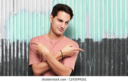 young handsome latin man confused expression