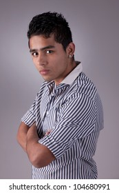 young and handsome latin man,serious, studio shot