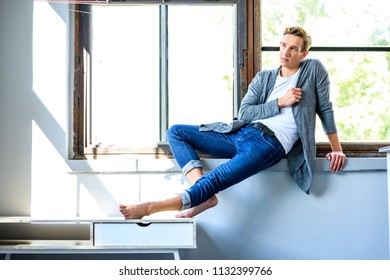 A young handsome male Dancer resting in a modern Loft Apartment