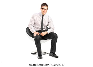 A young handsome male sitting on a chair isolated on white background