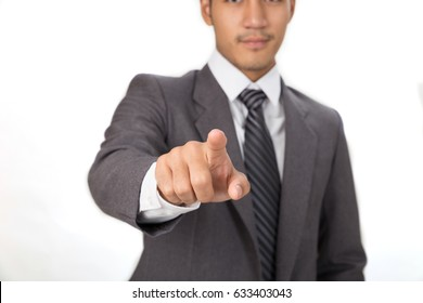 A young handsome male startup entrepreneur Businessman wearing gray suit standing and pointing at camera over white background
