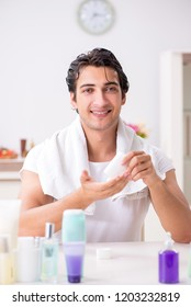 Young handsome man in the bathroom in hygiene concept