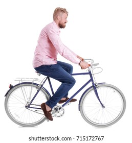 Young handsome man with bicycle on white background