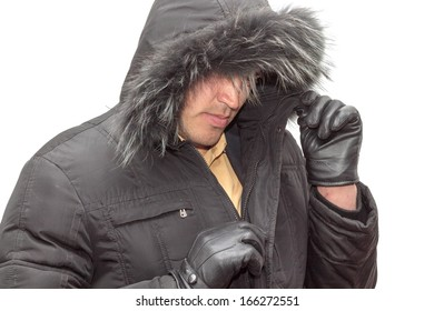 young handsome man in black fur hood winter jacket