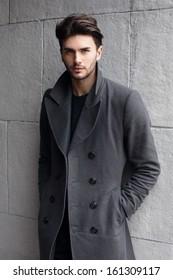 Young handsome man in coat