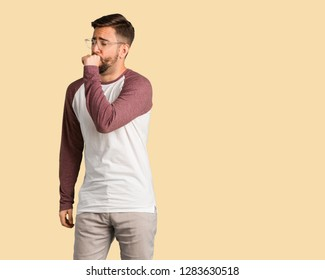 Young handsome man coughing, sick due a virus or infection