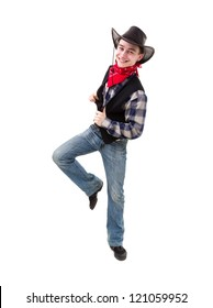 Young handsome man in cowboy's hat dancing against isolated white background