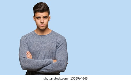 Young handsome man crossing arms relaxed