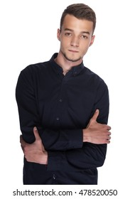 Young handsome man in a dark shirt on white background.