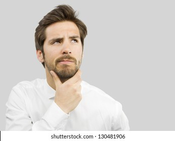 young handsome man doubting isolated over gray background