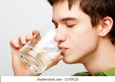 young handsome man is drinking mineral water