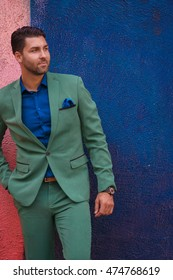 Young handsome man in a green suit
