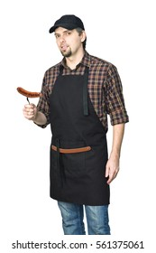 Young handsome man grilling, cooking meat sausage isolated