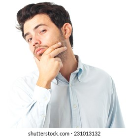 young handsome man with hand on chin imagine gesture on a white