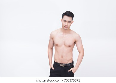 Young handsome man or healthy Asian man with six pack isolated on white background
