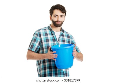 Young handsome man holding plastic blue bucket.