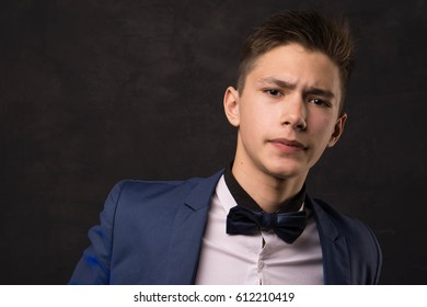 Young handsome man in jacket and shirt serious portrait
