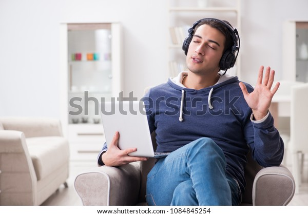 Young handsome man listening to music with headphones