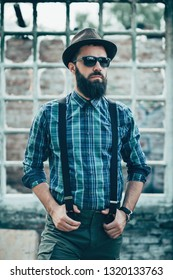 Young and handsome man with a long beard, posing outdoor. Colorized. Film - Cinematic effect.