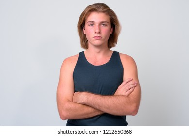 Young handsome man with long blond hair