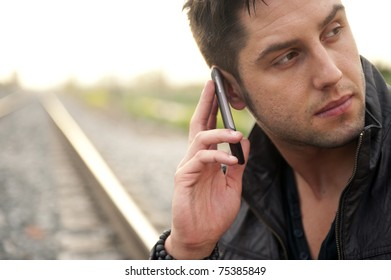 Young handsome man on railway