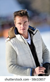 young handsome man outdoor in winter