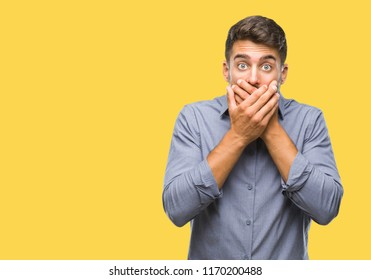Young handsome man over isolated background shocked covering mouth with hands for mistake. Secret concept.