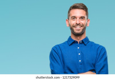 Young handsome man over isolated background happy face smiling with crossed arms looking at the camera. Positive person.