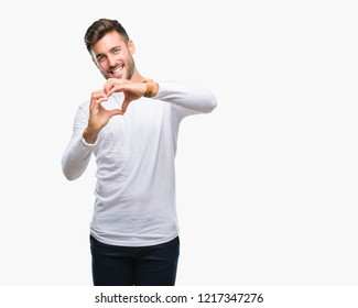 Young handsome man over isolated background smiling in love showing heart symbol and shape with hands. Romantic concept.
